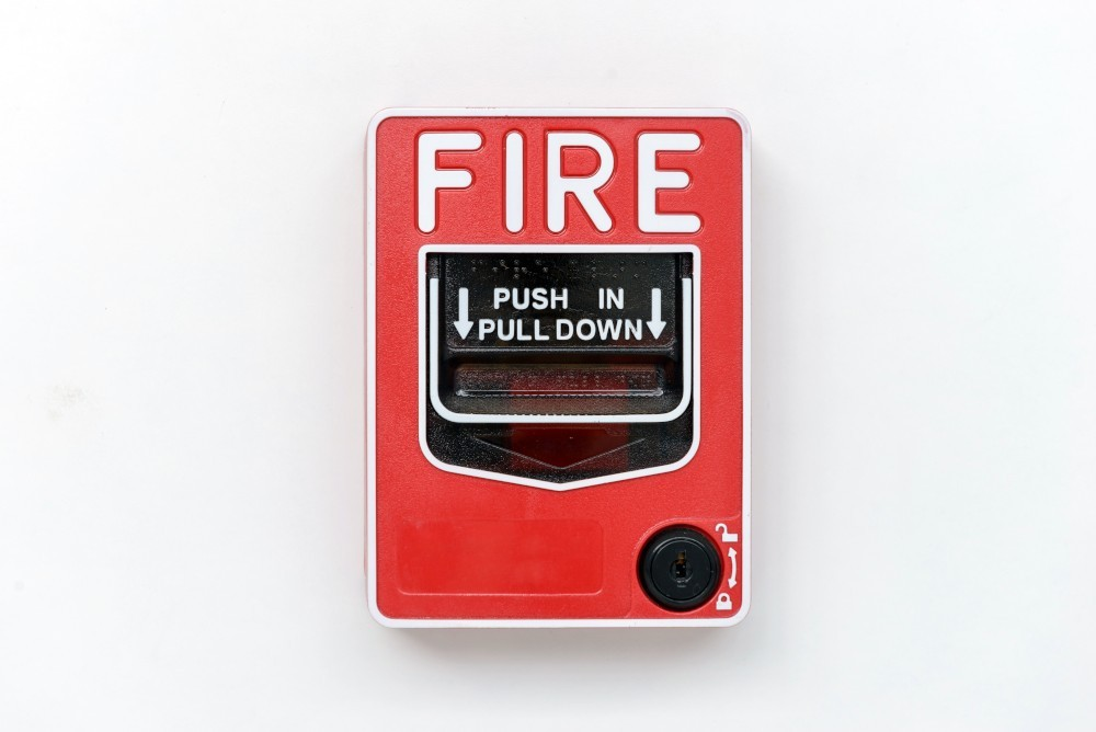 Fire alarm switch box on white wall for warning